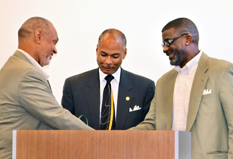 David Bodiford and Donald Anthony, present award to board member Cullen Daniels, III